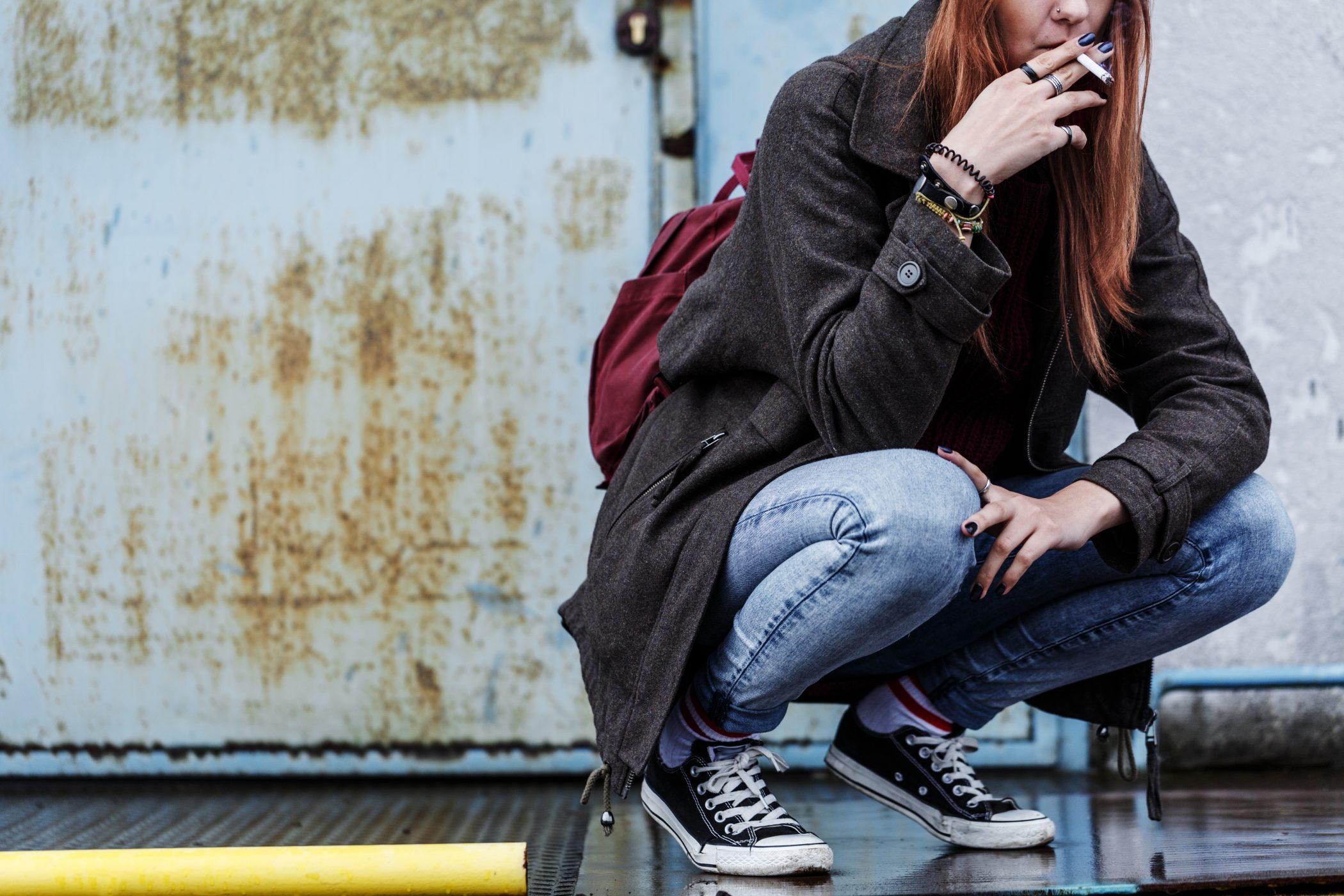 Riotous teenager smoking cigarette